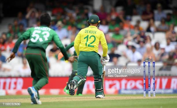 Quinton De Kock of South Africa is run out by Mushfiqur Rahim of Bangladesh during the Group Stage match of the ICC Cricket World Cup 2019 between...