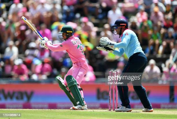 Quinton De Kock of South Africa plays a shot as Jonny Bairstow of England looks on during the 3rd One Day International match between England and...