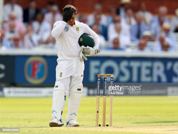 Quinton de Kock of South Africa reacts after his stumping of Joe Root is disallowed due to it being a no ball during day one of the 1st Investec Test...