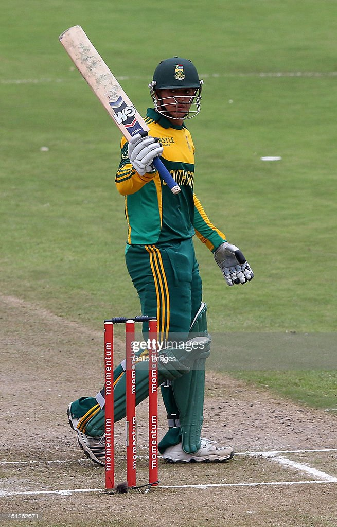 Quinton de Kock reaches 50 runs during the 2nd Momentum ODI match between South Africa and India at Sahara Stadium Kingsmead on December 08, 2013 in Durban, South Africa.