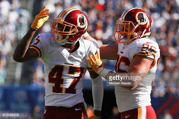 Quinton Dunbar and Houston Bates of the Washington Redskins celebrates after a succesful fake punt in the second half against the New York Giants at...