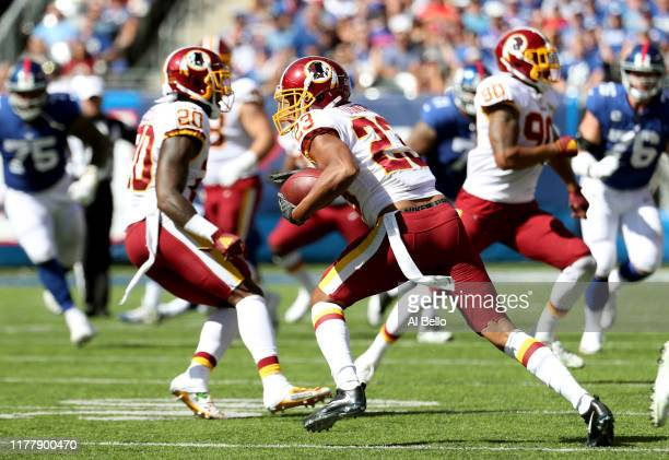 Quinton Dunbar of the Washington Redskins intercepts a pass thrown by Daniel Jones of the New York Giants during the second quarter in the game at...