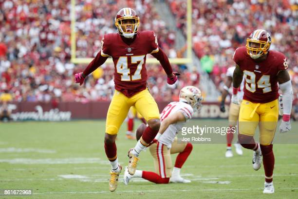 Quinton Dunbar of the Washington Redskins reacts after making a tackle for loss in the first quarter of a game against the San Francisco 49ers at...