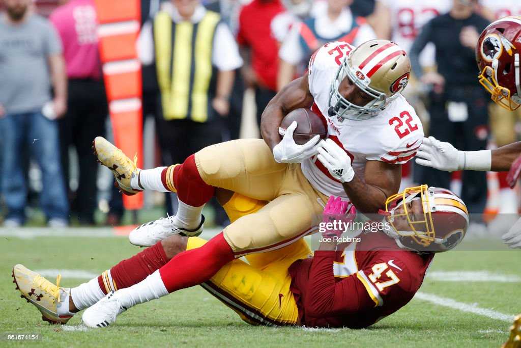 Quinton Dunbar #47 of the Washington Redskins tackles Matt Breida #22 of the San Francisco 49ers in the second quarter of a game at FedEx Field on October 15, 2017 in Landover, Maryland.