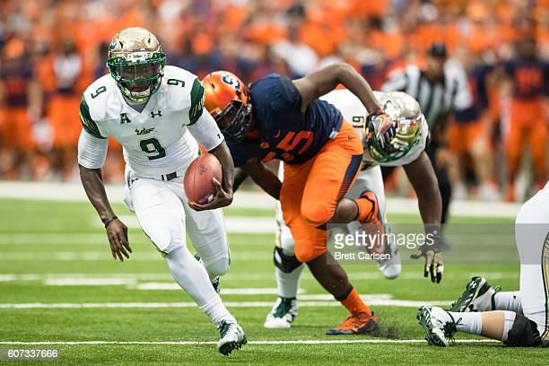 Quinton Flowers of the South Florida Bulls carries the ball on a quarterback keeper during the first half against the Syracuse Orange on September 17...