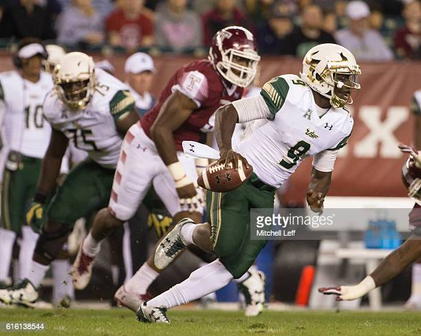Quinton Flowers of the South Florida Bulls runs with the ball against the Temple Owls in the second quarter at Lincoln Financial Field on October 21...