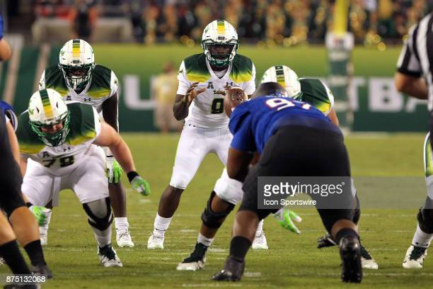 Quinton Flowers of USF waits for the snap of the ball during the game between the Tulsa Golden Hurricane and the USF Bulls on November 16 at Raymond...