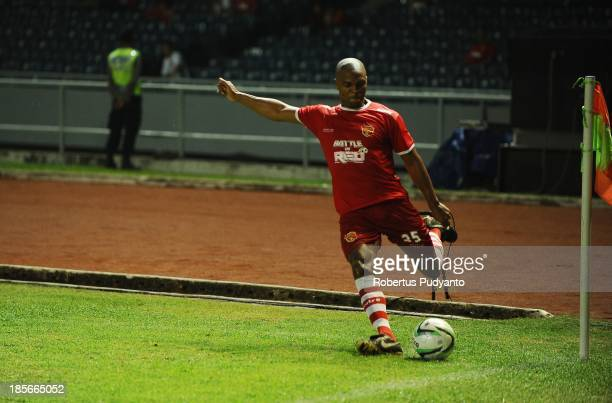Quinton Fortune kicks the ball during the friendly match between Indonesia Red and the Manchester United Legends on October 23 2013 in Jakarta...