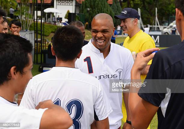 Quinton Fortune talks to young players during the Laureus All Stars Unity Cup ahead of the 2014 Laureus World Sports Awards at Royal Selangor Club on...