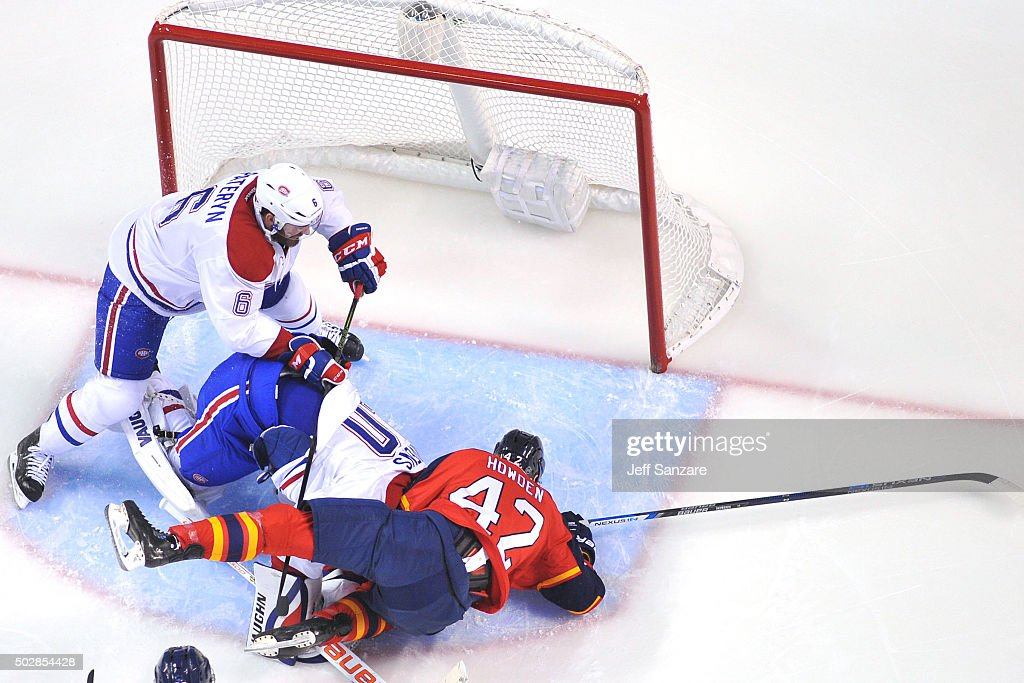 Quinton Howden #42 of the Florida Panthers collides with Goaltender Ben Scrivens #40 during second period action at the BB&T Center on December 29, 2015 in Sunrise, Florida.