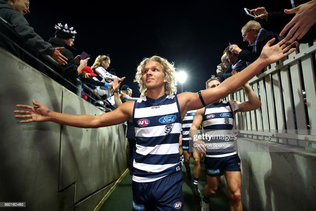 Quinton Narkle of the Cats and team mates leave the field after winning the round 16 AFL match between the Sydney Swans and the Geelong Cats at Sydney Cricket Ground on July 5, 2018 in Sydney, Australia.