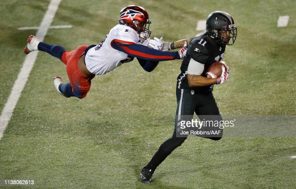 Quinton Patton of the Birmingham Iron catches a firstdown pass on a fourthdown play against DeMarquis Gates of the Memphis Express during the second...