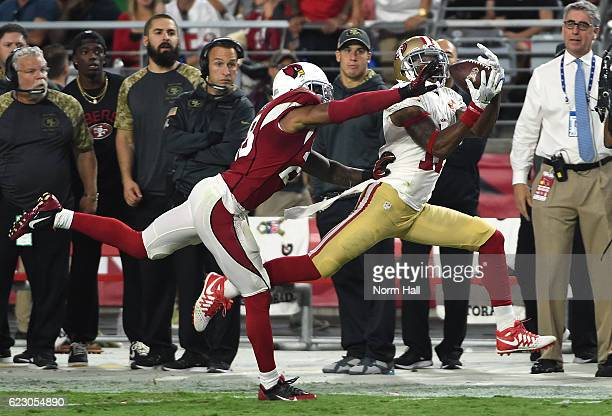 Quinton Patton of the San Francisco 49ers catches a pass while being defended by Justin Bethel of the Arizona Cardinals during the fourth quarter at...