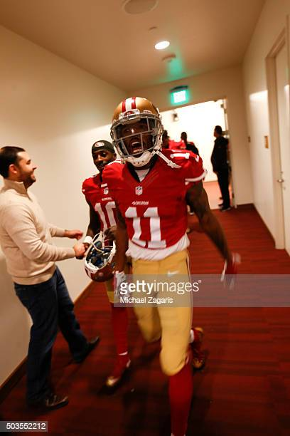 Quinton Patton of the San Francisco 49ers celebrates on his way to the locker room following the game against the St Louis Rams at Levi Stadium on...