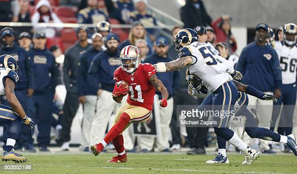 Quinton Patton of the San Francisco 49ers goes for a 33yards on a pass play during the game against the St Louis Rams at Levi Stadium on January 3...
