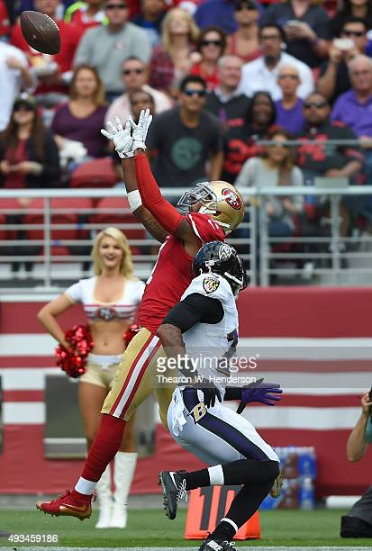 Quinton Patton of the San Francisco 49ers goes up for the ball over Jimmy Smith of the Baltimore Ravens during the first quarter of an NFL game at...