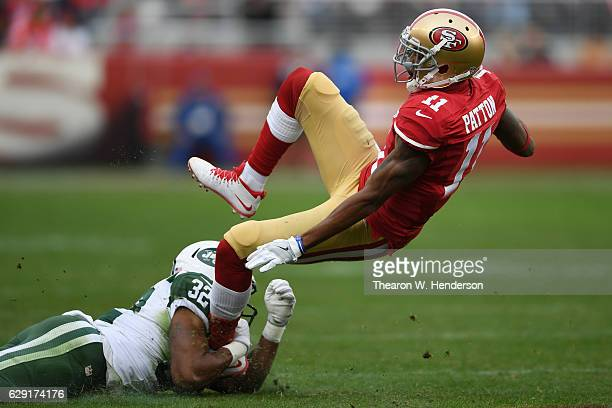 Quinton Patton of the San Francisco 49ers is tackled by Juston Burris of the New York Jets during their NFL game at Levi's Stadium on December 11...