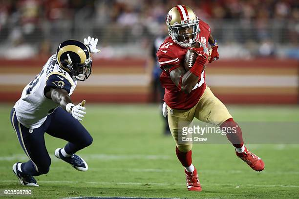Quinton Patton of the San Francisco 49ers runs with the ball after a catch against the Los Angeles Rams during their NFL game at Levi's Stadium on...