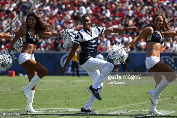 Quinton Peron performs with the Los Angeles Rams cheerleaders during the game between the Los Angeles Rams and the Oakland Raiders at Los Angeles...