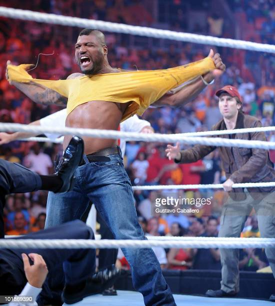 Quinton 'Rampage' Jackson and Sharlto Copley attend WWE Monday Night Raw at American Airlines Arena on June 7 2010 in Miami Florida