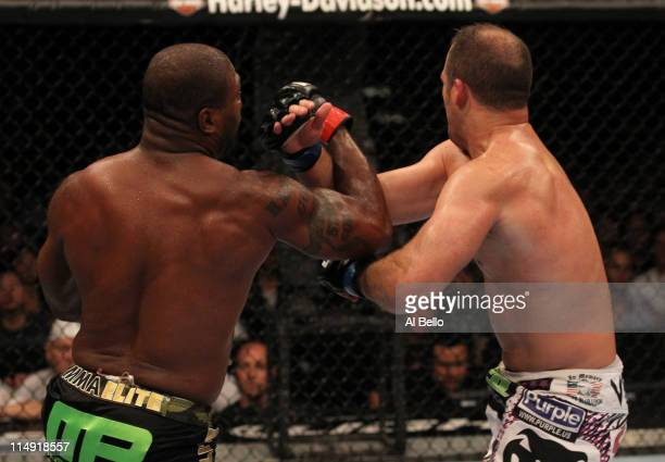"""Quinton """"Rampage"""" Jackson punches Matt Hamill during their light heavyweight fight at UFC 130 at the MGM Grand Garden Arena on May 28, 2011 in Las..."""