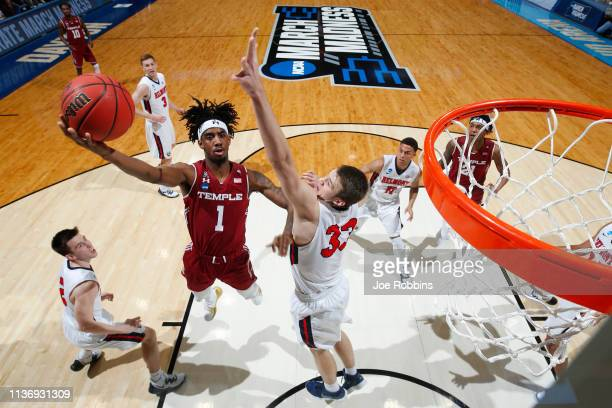 Quinton Rose of the Temple Owls drives to the basket against Nick Muszynski of the Belmont Bruins during the first half in the First Four of the 2019...