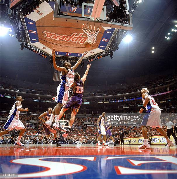 Quinton Ross of the Los Angeles Clippers reaches for the basket under pressure from Steve Nash of Phoenix Suns in game six of the Western Conference...