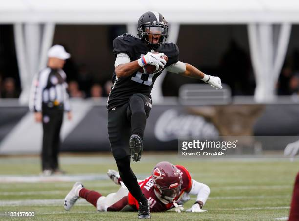 Quinton Patton of the Birmingham Iron runs with the ball as De'Vante Bausby of the San Antonio Commanders is unable to make the tackle during the...