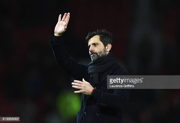 Quique Flores manager of Watford acknowledges the fans after the Barclays Premier League match between Manchester United and Watford at Old Trafford...