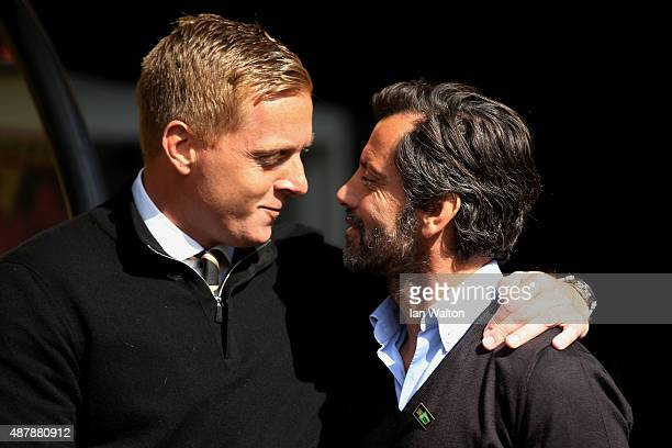 Quique Flores manager of Watford and Garry Monk manager of Swansea City in discussion prior to the Barclays Premier League match between Watford and...