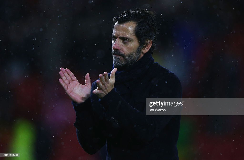 Quique Flores manager of Watford applauds the crowd after victory in the Emirates FA Cup Third Round match between Watford and Newcastle United at Vicarage Road on January 9, 2016 in Watford, England.