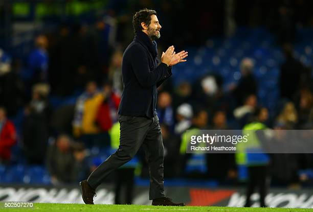 Quique Flores manager of Watford applauds the fans after the Barclays Premier League match between Chelsea and Watford at Stamford Bridge on December...