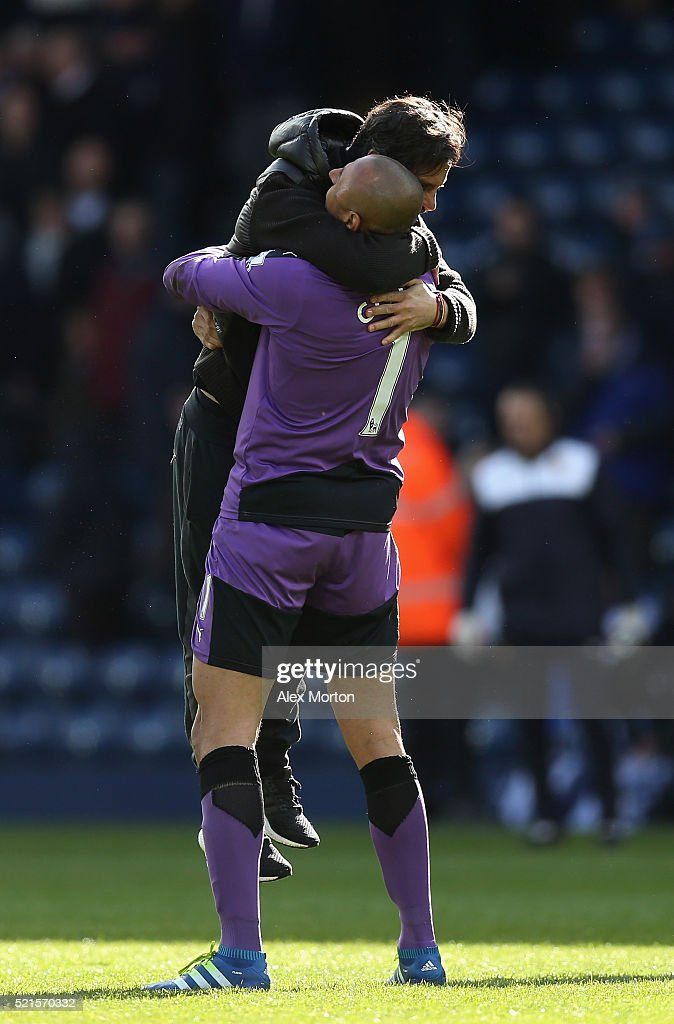 Quique Flores manager of Watford celebrates with Heurelho Gomes of Watford following his sides victory during the Barclays Premier League match between West Bromwich Albion and Watford at The Hawthorns on April 16, 2016 in West Bromwich, England.