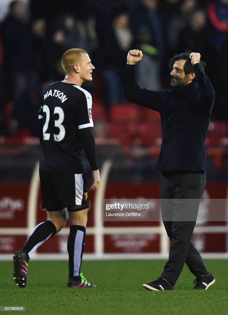 Quique Flores (R) manager of Watford celebrates with his player Ben Watson (L) winning the Emirates FA Cup fourth round between Nottingham Forest and Watford at City Ground on January 30, 2016 in Nottingham, England.