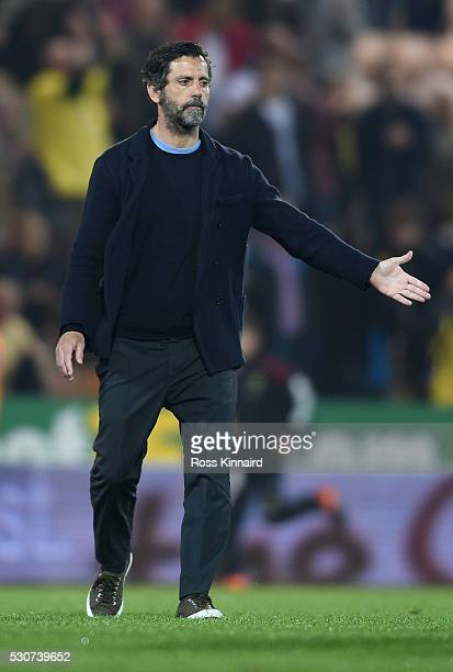 Quique Flores manager of Watford consoles Norwich City players after Norwich were relegated during the Barclays Premier League match between Norwich...