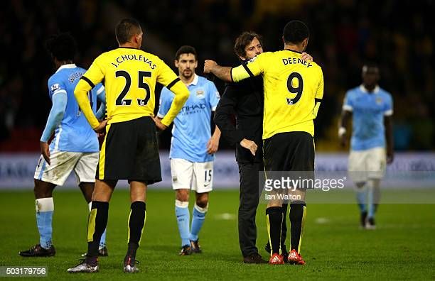Quique Flores Manager of Watford embraces Troy Deeney of Watford following their defeat during the Barclays Premier League match between Watford and...