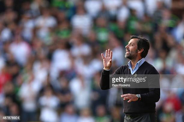 Quique Flores manager of Watford gives instructions during the Barclays Premier League match between Watford and Swansea City at Vicarage Road on...