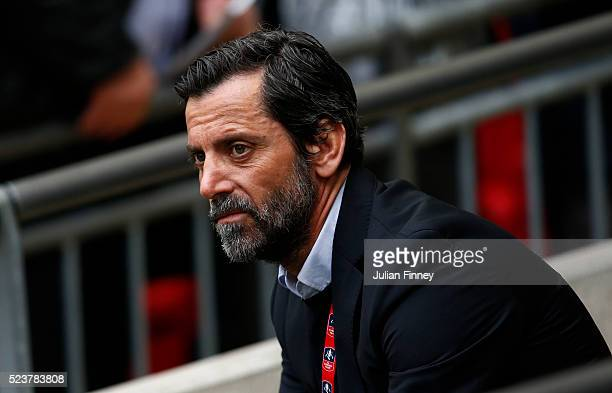 Quique Flores manager of Watford looks on prior to The Emirates FA Cup semi final match between Watford and Crystal Palace at Wembley Stadium on...