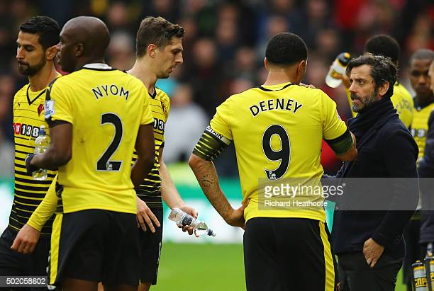 Quique Flores manager of Watford talks to Troy Deeney of Watford during the Barclays Premier League match between Watford and Liverpool at Vicarage...