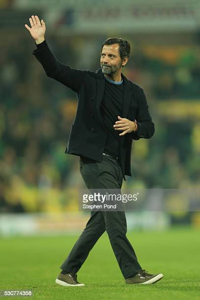 Quique Flores manager of Watford waves to supporters during the Barclays Premier League match between Norwich City and Watford at Carrow Road on May...