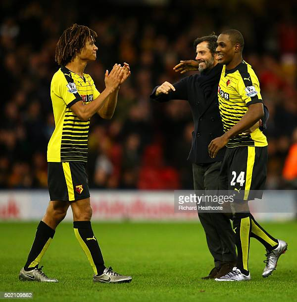 Quique Sanchez Flores manager of Watford celebrates victory with goalscorers Nathan Ake and Odion Ighalo after the Barclays Premier League match...