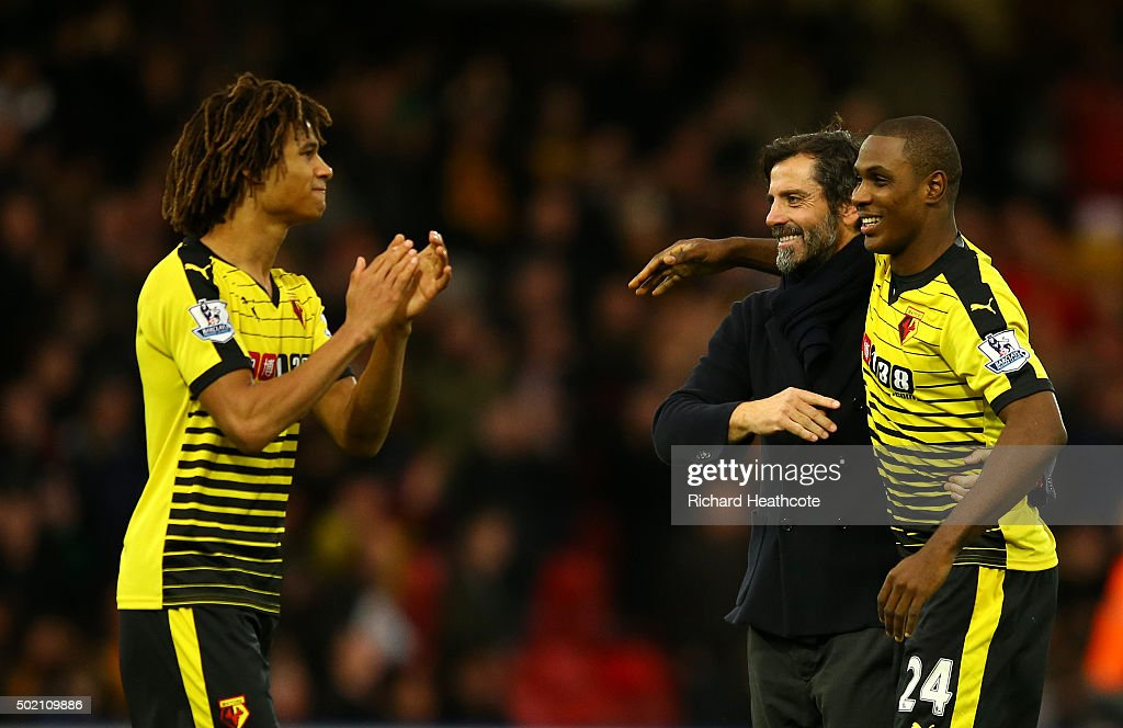 Quique Sanchez Flores, manager of Watford celebrates victory with goalscorers Nathan Ake (L) and Odion Ighalo after the Barclays Premier League match between Watford and Liverpool at Vicarage Road on December 20, 2015 in Watford, England.