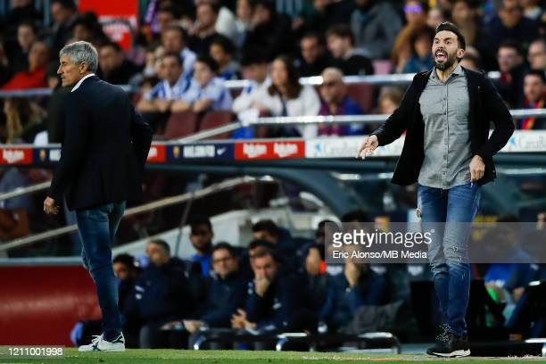 Quique Setien and Eder Sarabia of FC Barcelona make orders to the players during the Liga match between FC Barcelona and Real Sociedad at Camp Nou on...