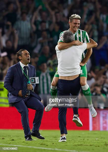 Quique Setien Manager of Betis and Joaquin Sanchez of Betis celebrate following their sides victory in the La Liga match between Real Betis Balompie...