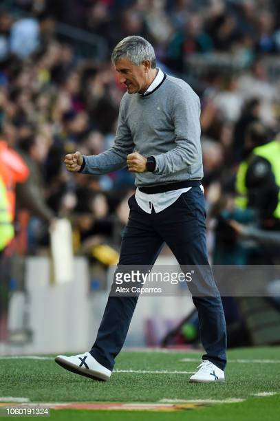Quique Setien manager of Real Betis celebrates his team's second goal during the La Liga match between FC Barcelona and Real Betis Balompie at Camp...