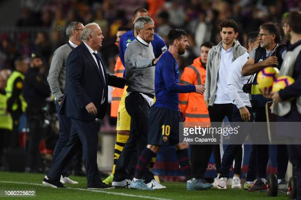 Quique Setien manager of Real Betis pats Lionel Messi of Barcelona on the back after the La Liga match between FC Barcelona and Real Betis Balompie...