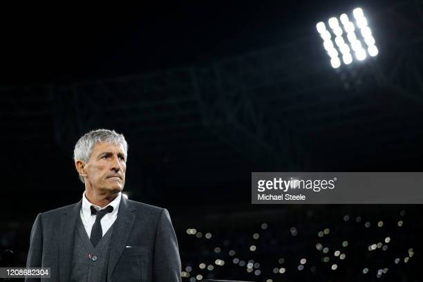 Quique Setien the coach of Barcelona looks on during the UEFA Champions League round of 16 first leg match between SSC Napoli and FC Barcelona at...