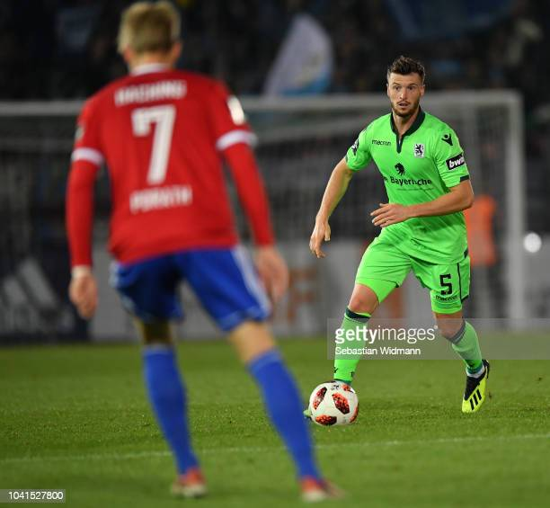 Quirin Moll of 1860 Muenchen plays the ball during the 3. Liga match between SpVgg Unterhaching and TSV 1860 Muenchen at Alpenbauer Sportpark on...