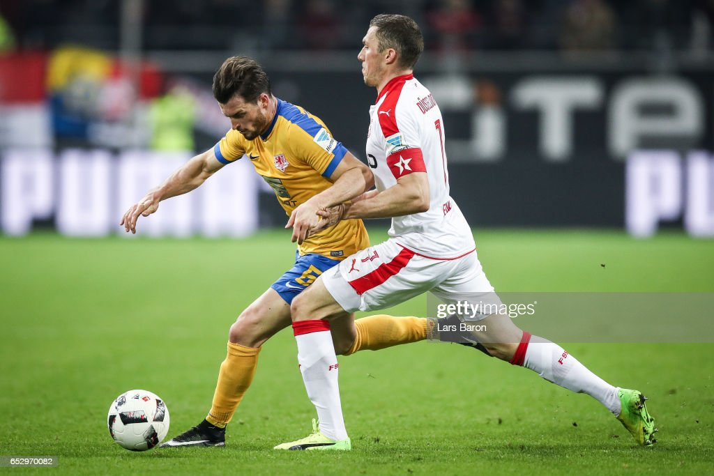 Quirin Moll of Braunschweig (L) and Oliver Fink of Duesseldorf battle for the ball during the Second Bundesliga match between Fortuna Duesseldorf and Eintracht Braunschweig at Esprit-Arena on March 13, 2017 in Duesseldorf, Germany.