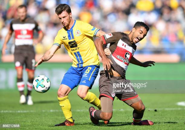 Quirin Moll of Braunschweig is challenged by Sami Allagui of St Pauli during the Second Bundesliga match between Eintracht Braunschweig and FC St...
